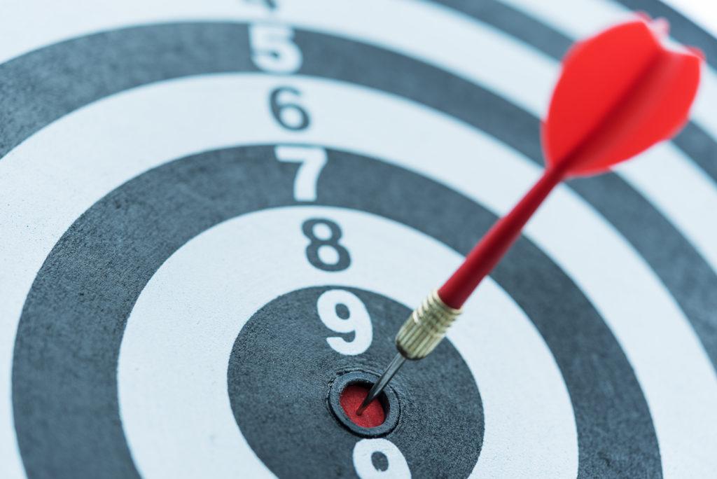An image of a target arrow hitting on bullseye with sun light