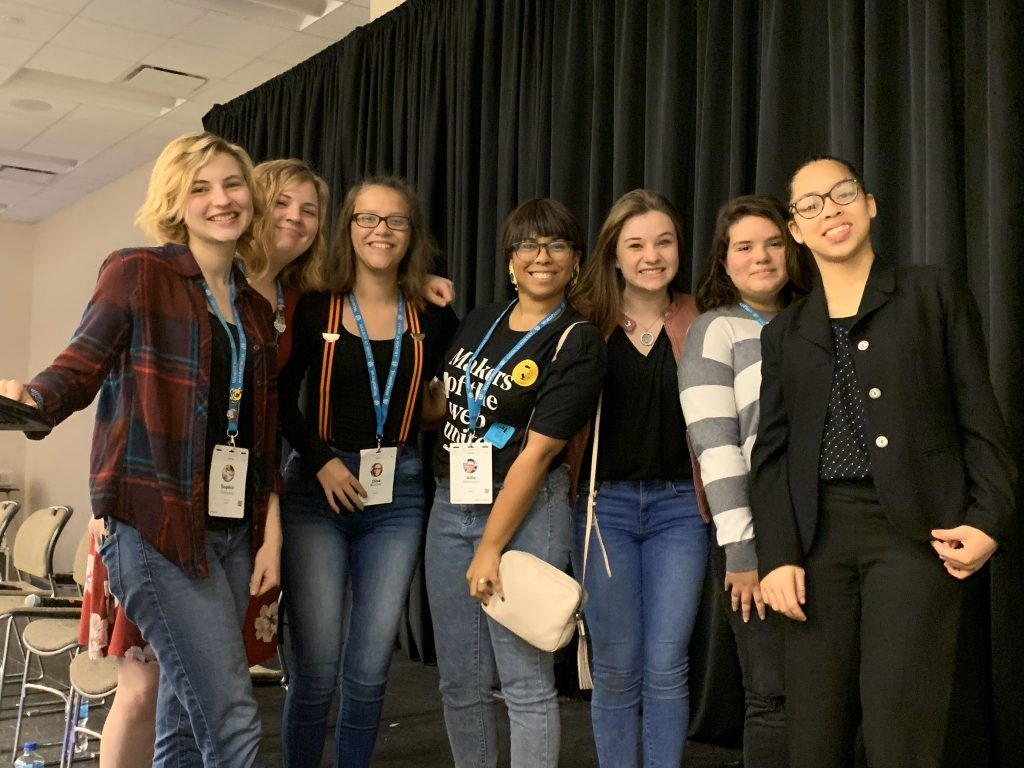 At WordCamp US, 6 amazing young women spoke about how they use WordPress. Here is a photo of me posing with them.